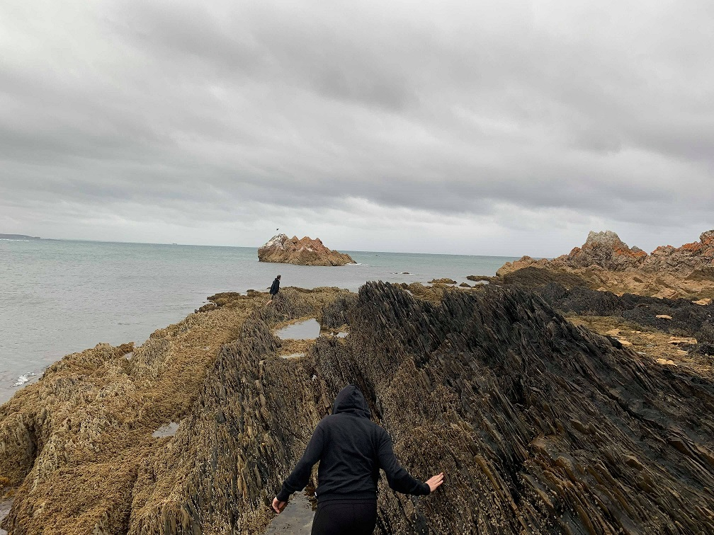 Navigating the sharp upright rocks at Rocky Cape. Photo by Millie Banner